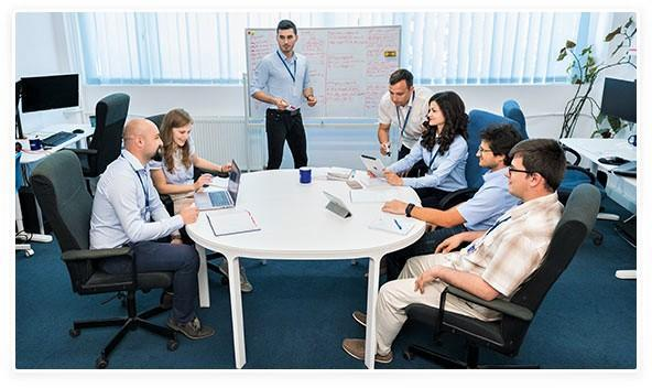 Why are dedicated teams important for software development outsourcing projects