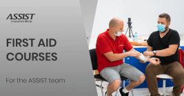 Team members learning first aid at ASSIST HQ
